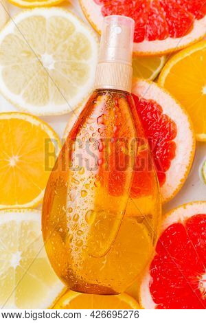 Suntan Oil And Citrus Fruits . Skin Care. Uniform Tan. Cosmetology. An Article About The Choice Of F
