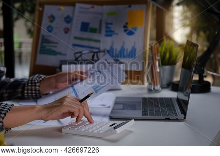 A Business Woman Accountant Or Banker Does An Audit And Calculates Expenses For A Financial Report B