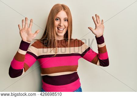 Young irish woman wearing casual clothes showing and pointing up with fingers number ten while smiling confident and happy.