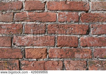 Old Red Brick Wall. Antique Brickwork. Cracks And Chips In Old Brick