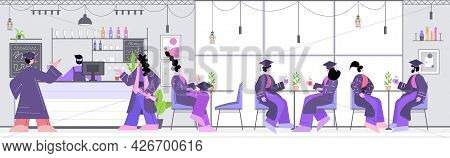 Graduated Students Discussing During Meeting In Cafe Graduates Celebrating Academic Diploma Degree E