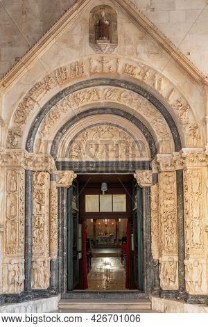 Trogir, Croatia - September 9, 2019: Radovan's portal of the St Lawrence cathedral church in Trogir, Croatia.