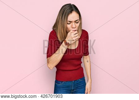 Young blonde girl wearing casual clothes feeling unwell and coughing as symptom for cold or bronchitis. health care concept.