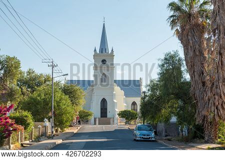 Prince Albert, South Africa - April 20, 2021: A Street Scene, With The Dutch Reformed Church, In Pri