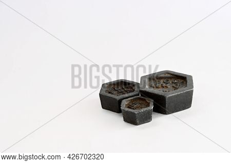 Black Standard Metric Weights Made Of Iron For Weighing Scales On White Background