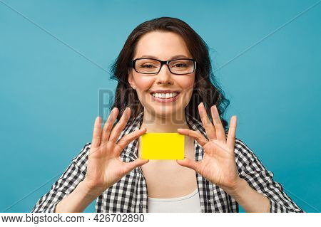 Cute Smiling Woman In Dress Shirt And Eyeglasses, Showing Credit Card In Hand For Financial And Cash