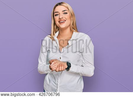 Young caucasian woman wearing casual clothes with hands together and crossed fingers smiling relaxed and cheerful. success and optimistic