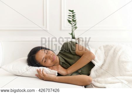 Serene And Calm Beautiful Indian Woman Sleeping In A Daytime On The Comfortable Sofa At Home, Carefr