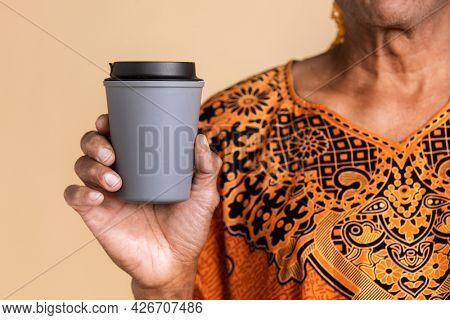 Indian man holding a tumbler mockup