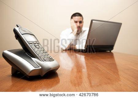 Bored Man Sitting At Laptop