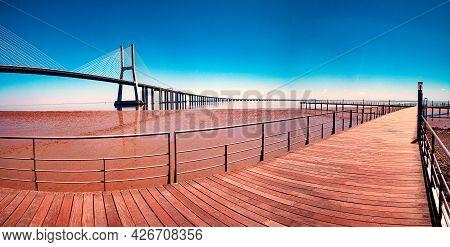 Lisbon,portugal. Colorful Street Photography. Scenic Landscape And Tourism.vasco Da Gama Bridge Over