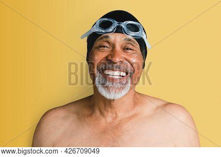 Cheerful senior man wearing swimming glasses mockup
