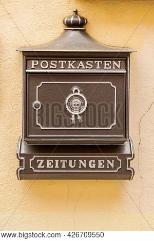 Nuremberg, Germany - May 17, 2016: German letterbox on the wall close-up