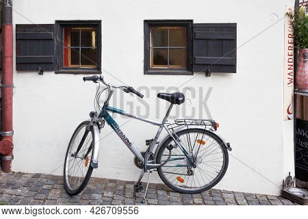 Nuremberg, Germany - May 17, 2016:  Bicycle by the house wall in the old town of Nuremberg