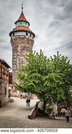 Nuremberg, Germany - May 17, 2016:  Sinwell tower in Kaiserburg in the old town of Nuremberg. Landmark of the city, cityscape