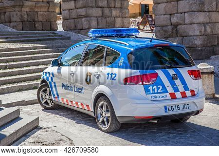 Segovia, Spain - September 21, 2015: Police car Seat Altea XL by Roman aqueduct in Segovia