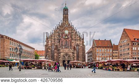 Nuremberg, Germany - May 17, 2016:  Frauenkirche church and Main Market Square in Nuermberg. Panoramic view, cityscape
