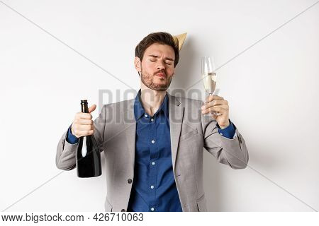 Celebration And Holidays Concept. Drunk Guy Having Fun At Birthday Party, Dancing With Glass Of Cham
