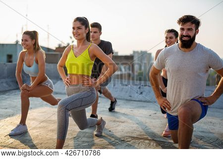 Group Of Fit Healthy Friend, People Exercising Together Outdoor