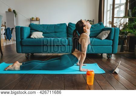 Young Woman Is Engaged In Fitness At Home.
