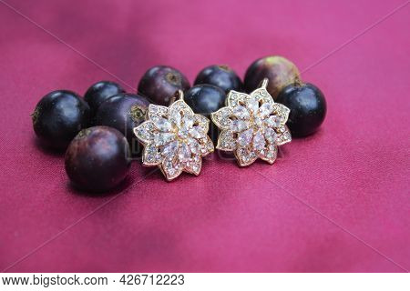 Black Currant In Combination With Gold Earrings.
