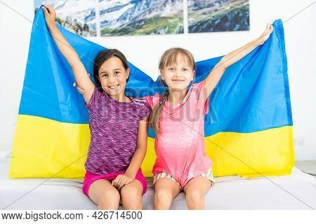 Children Carry Fluttering Flag Of Ukraine. Ukraines Independence Day. Flag Day. Constitution Day. Gi