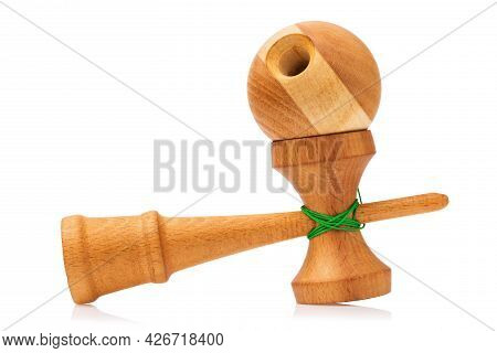Childrens Wooden Kendama Toy With Green Threads Isolated On White Background