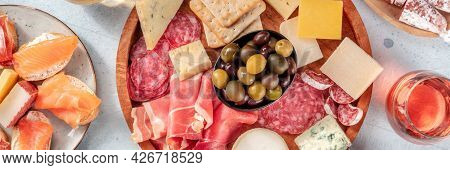 Charcuterie And Cheese Platter Panorama With Rose Wine And Salmon Sandwiches, Top Shot. A Panoramic
