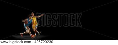 Flyer. Basketball Players In Action And Motion Isolated On Dark Black Studio Background. Advertising
