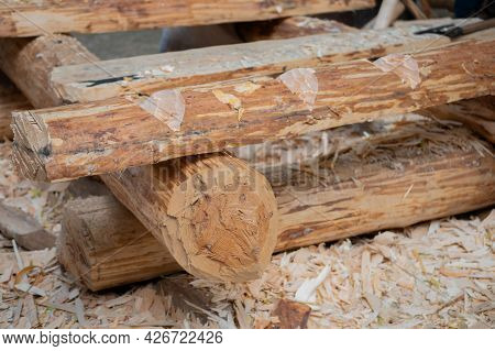 Unfinished Rustic Log Cabin Building - Outdoor, Summer Time. Logging, Environment And Construction C