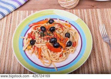 Linguini Pasta With Pepper, Basil And Olive Sauce - Portion In A Plate, Close-up