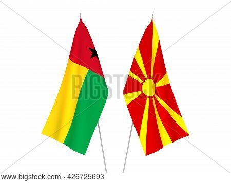 National Fabric Flags Of North Macedonia And Republic Of Guinea Bissau Isolated On White Background.