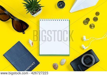 Summer Travel Planning. Passport, Sun Glasses, Camera And Money On A Yellow Background. Flatlay, Pla