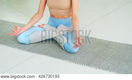 Young girl in yoga lotus position in the living room