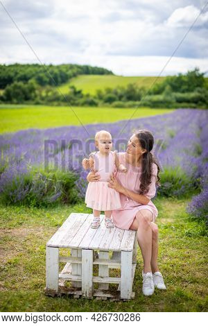 Mother With Her Little Daugher On Lavender Field Background In Czech Republic