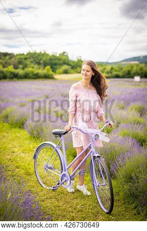 Woman In Pink Dress With Retro Bicycle In Lavender Field In Czech Republic