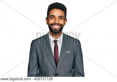 Young african american man wearing business clothes with a happy and cool smile on face. lucky person.