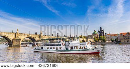 Panorama Of A Tourist Boat On The River Vltava (moldau) In Prague, Czech Republic
