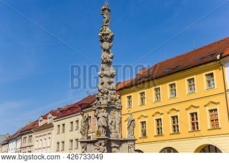 Statues On The Column In Front Of Colorful Houses In Kutna Hora, Czech Republic