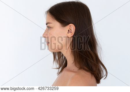 Bare chested woman in studio shoot