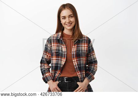 Image Of Young Queer Woman In Checked Shirt, University Student In Casual Clothes Smiling, Looking F