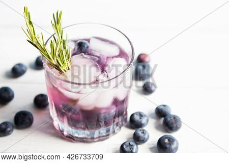 Chilled Water, Soda Water With Ice And Fresh Berries, Garnished With A Sprig Of Rosemary. Summer Dri