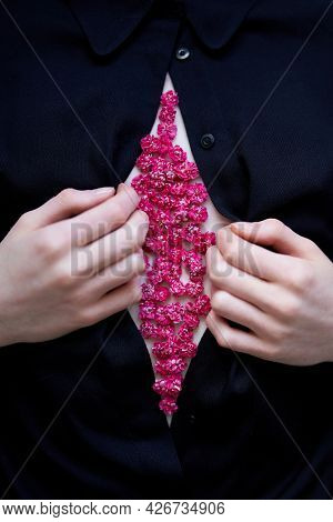 Aesthetic Flowers Usage Concept. Gvfwoman Opens Black Blouse With Hands And There Is A Bunch Of Pink