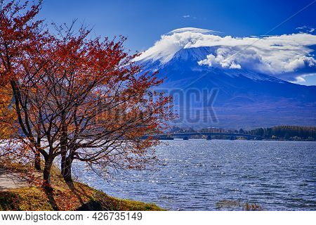Japanese Travel Destinations. Kawaguchiko Lake In Front Of Picturesque Fuji Mountain With Beidge In