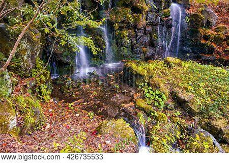 Japanese Travel Concepts. Scenery Of Tranquil Multiple Waterfalls At Kawaguchiko Lake In Japan At Fa