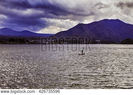 Japanese Travel Destinations. Kawaguchiko Lake In Front Of Picturesque Fuji Mountain With Boat In Fo