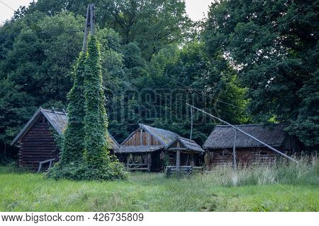 A Complex Of Historic Wooden Cottages And A Well, Bedkowice Archeological Reserve, Sobotka, Poland.