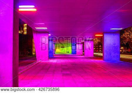 Dutch Travel Destinations. Mulitcolored Illuminated Rainbow Gallery Tunnel Near The Nai Building In