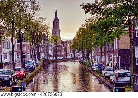 Dutch Travel Ideas. One Of Traditional Dutch Channel Located In Old City Delft During Picturesque Su