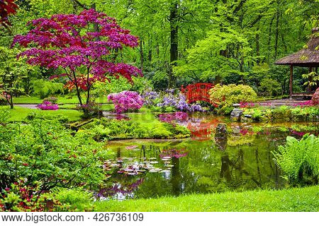 Travel Through The Netherlands. Japanese Garden With Asian Zen Sculptures  On Background In Park Cli